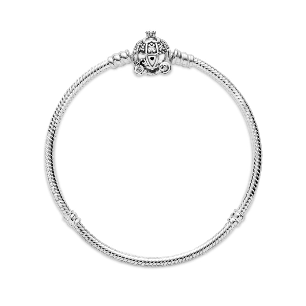 Flat lay of Disney Cinderella Pumpkin Coach Clasp Pandora Moments Bracelet is Hand-finished in sterling silver.  The clasp features a pumpkin carriage with stone settings for windows, four hearts that form a clover and a 3D crown on the roof, a grooved heart for a door handle and pumpkin wheels.