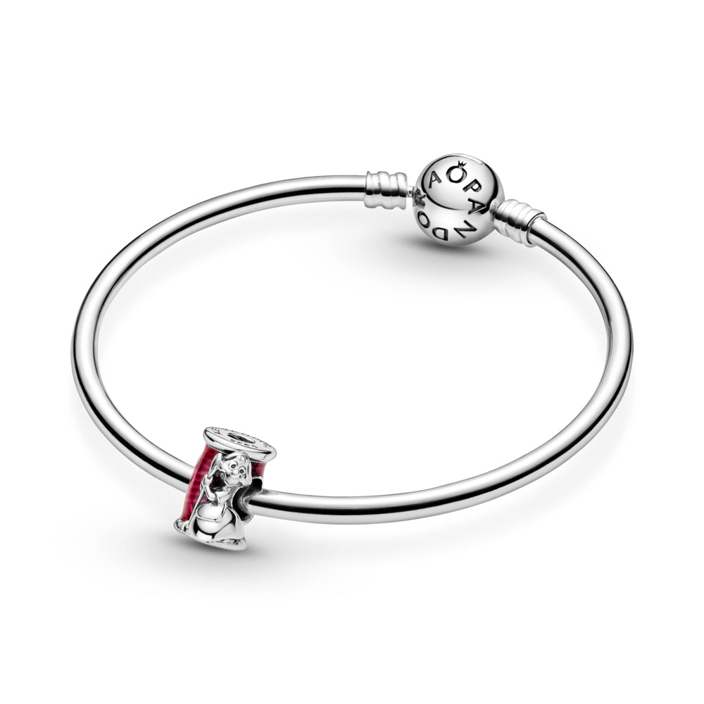 Pandora Disney Cinderella Suzy Mouse Needle & Thread Charm in sterling silver featured on smooth Pandora Moments bangle bracelet. Suzy is holding a needle while hugging a thread spool decorated with hand-applied transparent cerise enamel to highlight the thread details.