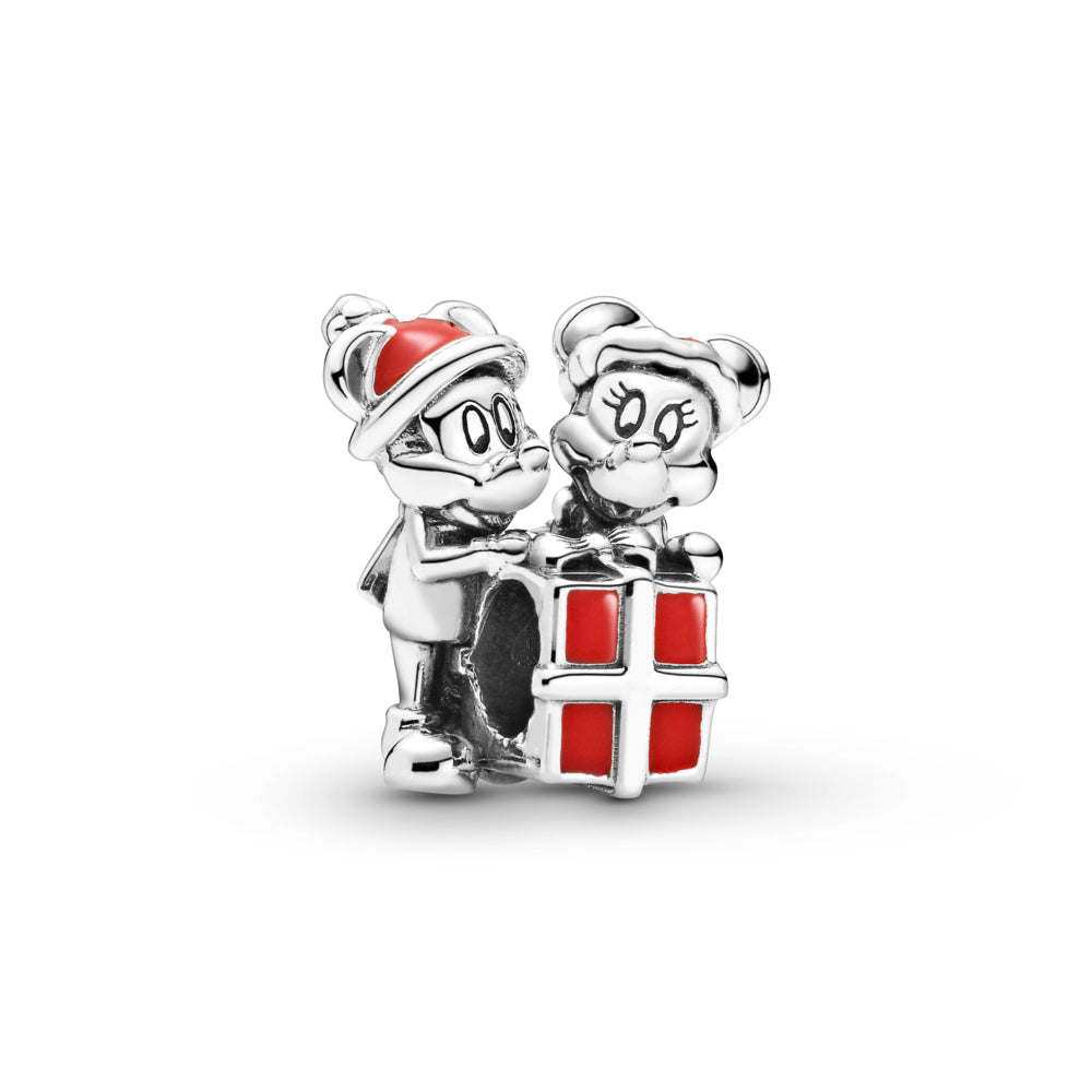 Pandora Disney Mickey & Minnie Mouse Present Charm in sterling silver.  Mickey & Minnie are holding a red present. Mickey is wearing a scarf. Both have grooved eyes and eyelashes to highlight their features and are wearing Christmas hats in red enamel.