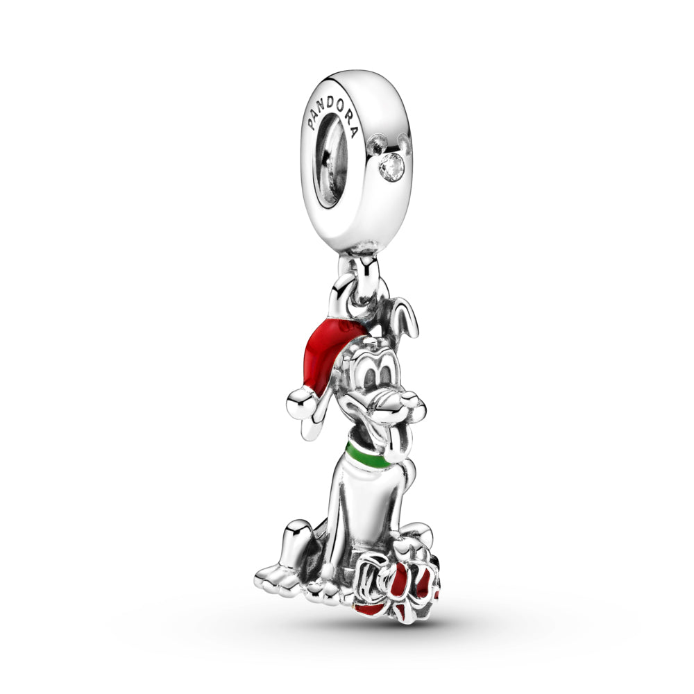 Pandora Disney Pluto Christmas Gift Charm in sterling silver. Pluto is sitting with his tongue out in front of a red present with a bow, wearing a green collar, and a red Christmas hat. The silhouette of Mickey Mouse is featured on the bail with a stone set in the center.