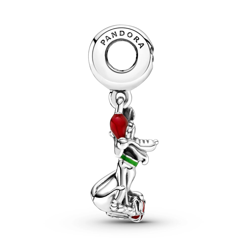 Profile view of Pandora Disney Pluto Christmas Gift Charm in sterling silver. Pluto is sitting with his tongue out in front of a red present with a bow, wearing a green collar, and a red Christmas hat. The silhouette of Mickey Mouse is featured on the bail with a stone set in the center.
