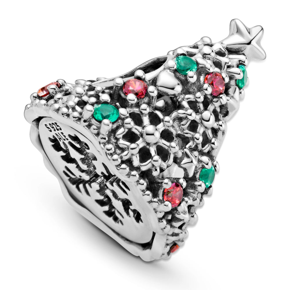 Close up of Pandora Glitter Christmas Tree Charm in sterling silver. The openwork Christmas tree has stars, hearts, snowflakes, red, and green stones for decorations, including a 5-point star on top and a cut-out snowflake underneath the tree.