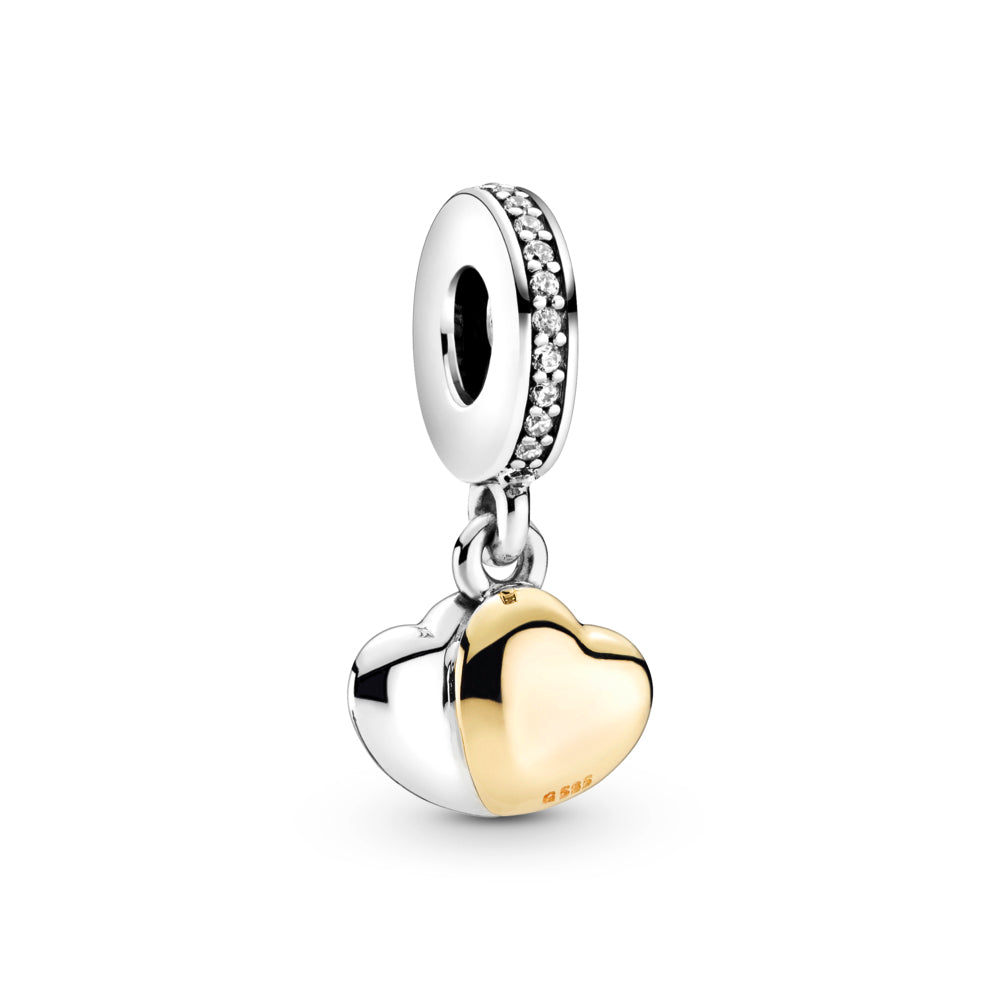 "Pandora Double Heart Dangle Charm in sterling silver and 14k gold, this design includes two heart-shaped discs that overlap at an angle and are fixed together. The front 14k gold heart is placed inside a silver frame. The angled engravings ""Always"" and ""Forever"" are on the back of the hearts, with clear czs on the bail."