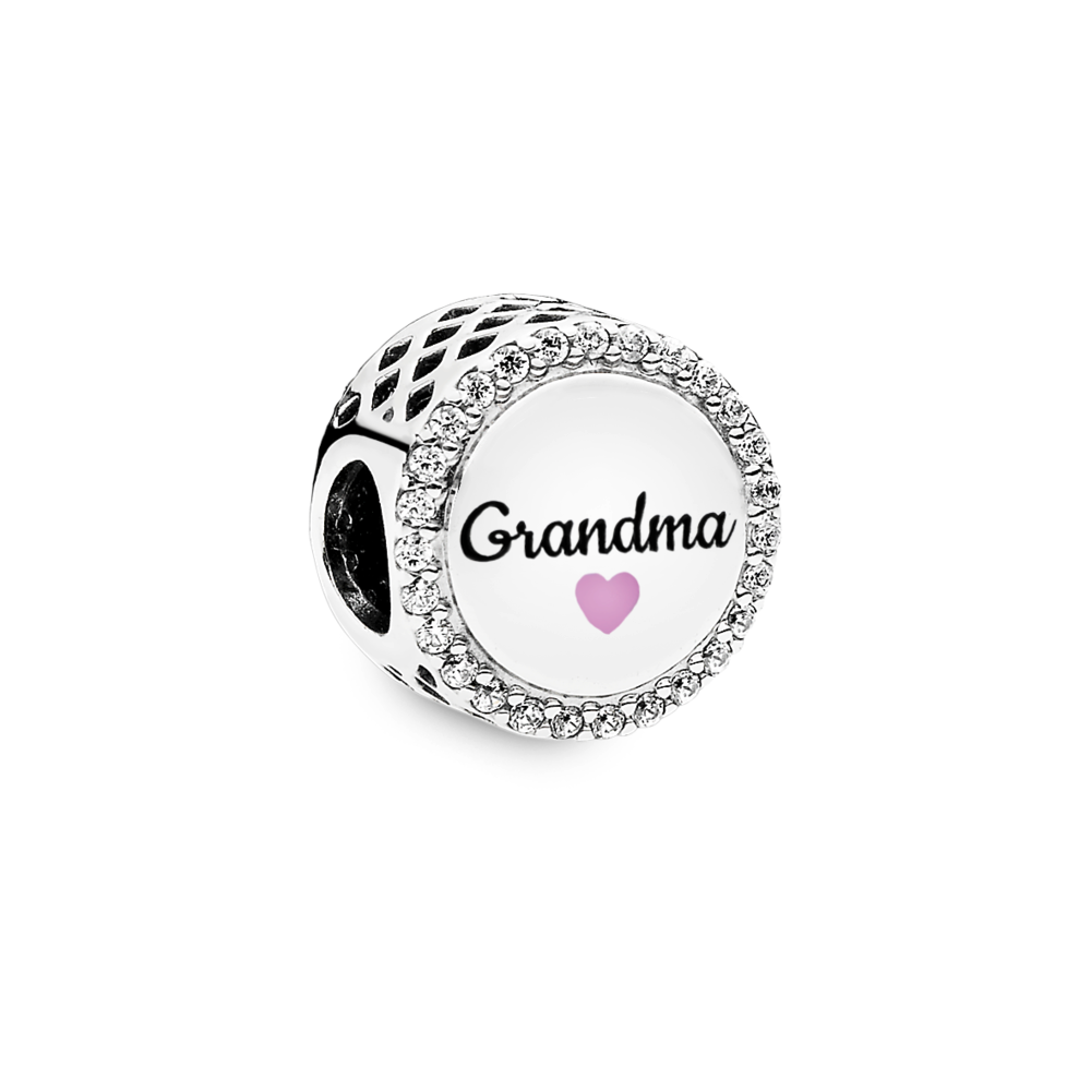 Pandora Grandma charm in sterling silver with sparkling czs on the edge of the button shaped charm. There is a pink enamel heart beneath Grandma in script font.