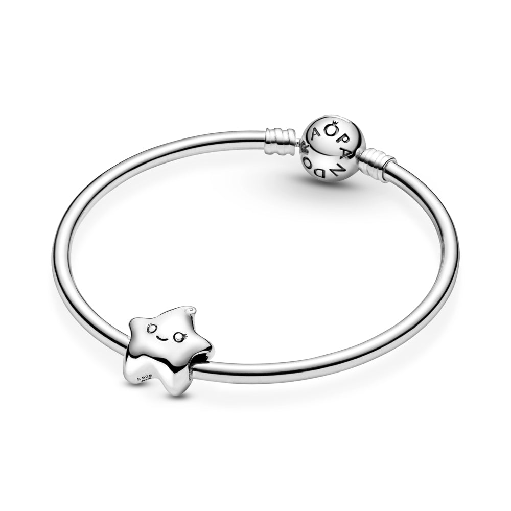 Pandora Isa the Star Charm in sterling silver featured on Pandora moments bangle bracelet. This star design includes a grooved smiling mouth, eyes with pretty eyelash details and a cute swirl on top.
