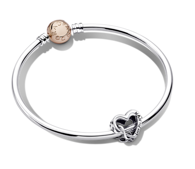 Pandora My Whole Heart Bangle Gift Set features the Love You Mom Infinity Heart in sterling silver featured on the smooth Pandora moments sterling silver bangle with Rose clasp.
