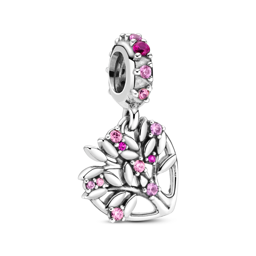 Pandora Pink Heart Family Tree Dangle Charm. Hand-finished in sterling silver, inside the heart shape stands a tree at an angle with its leaves extending beyond the outline. The leaves are decorated with pink stones in various shades. This effect is mirrored on the bail for a decorative finish.