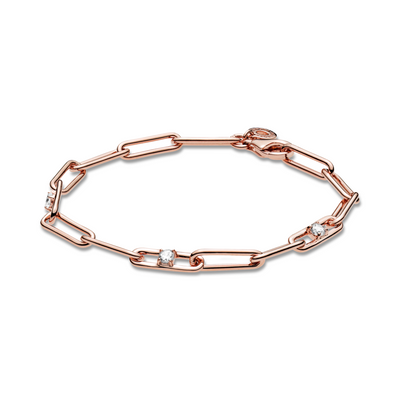 Pandora Link Chain & Stones Bracelet. This classic, modern design is hand-finished in 14k rose gold-plated unique metal blend. Features clear sparkling cubic zirconia on three of the bracelet's links, includes a dangling tag on the closure link.