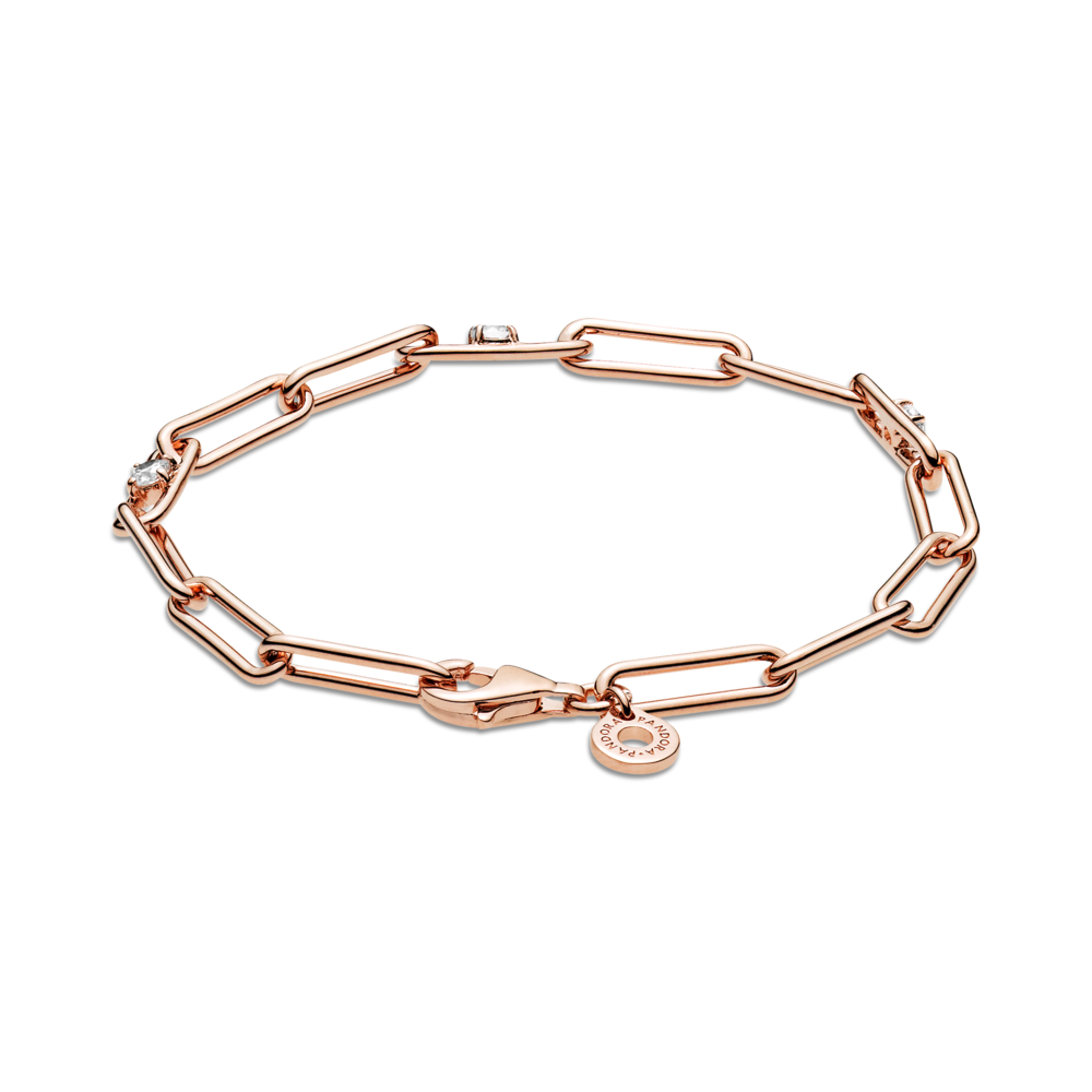 Pandora Link Chain & Stones Bracelet. This classic, modern design is hand-finished in 14k rose gold-plated unique metal blend. Features clear sparkling cubic zirconia on three of the bracelet's links. Lobster claw closure is shown at the front highlighting the Pandora O dangling tag.