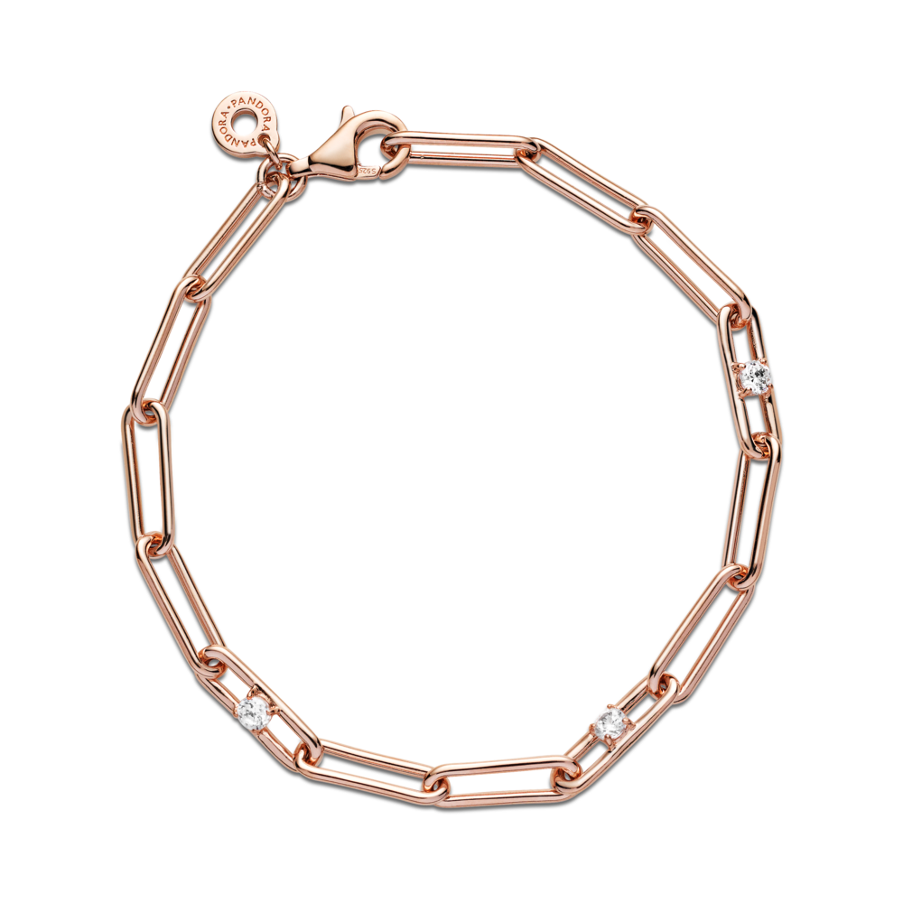 Flat lay view of Pandora Link Chain & Stones Bracelet. This classic, modern design is hand-finished in 14k rose gold-plated unique metal blend. Features clear sparkling cubic zirconia on three of the bracelet's links, includes a dangling tag on the closure link.