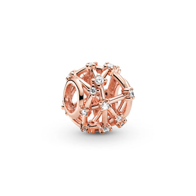 Pandora Openwork Star Constellations Charm in Pandora Rose™ gold-plated metal. Clear stones are set along the charm's rounded openwork lines to mimic the formation of the stars in space.