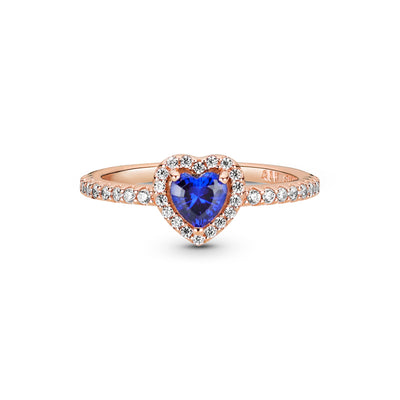 Pandora Rose™ Sparkling Blue Elevated Heart Ring. The ring has a blue heart-shaped central, elevated stone. Clear stones create the halo and decorate half of the ring shank
