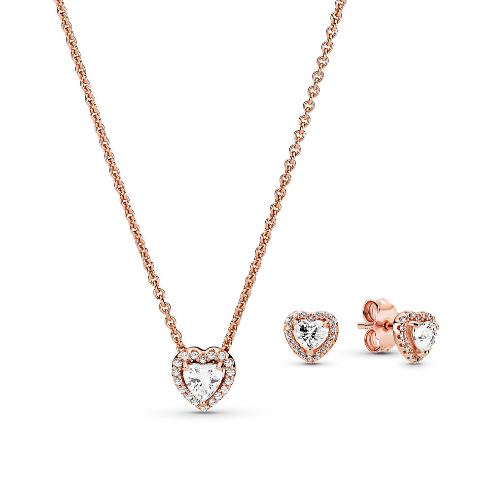 Pandora Rose Sparkling Elevated Heart Necklace & Stud Earrings gift set. The hearts have a raised heart-shaped cubic zirconia center with a stone-studded heart halo.