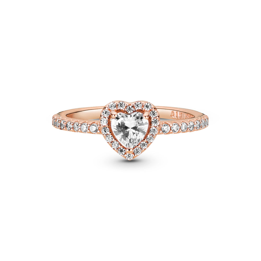 Pandora Sparkling Elevated Heart Ring in Pandora Rose. The ring has a clear heart-shaped central, elevated stone surrounded by small clear stones creating the halo and decorate half of the ring shank.