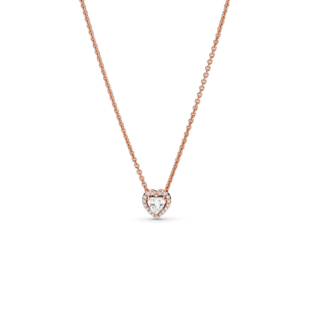 Pandora Sparkling Heart Necklace in Pandora Rose™, a 14k rose gold-plated unique metal blend. This necklace has a raised heart-shaped central stone surrounded by a halo of clear cubic zirconia, a Pandora crown O monogram logo tag is attached by the clasp.