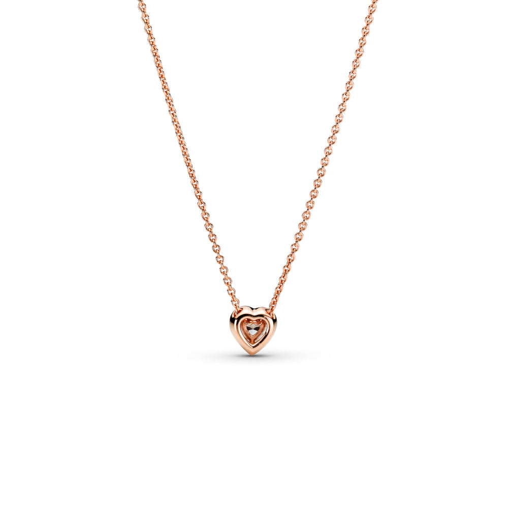 Back of Pandora Sparkling Heart Necklace in Pandora Rose™, a 14k rose gold-plated unique metal blend. This necklace has a raised heart-shaped central stone surrounded by a halo of clear cubic zirconia, a Pandora crown O monogram logo tag is attached by the clasp.
