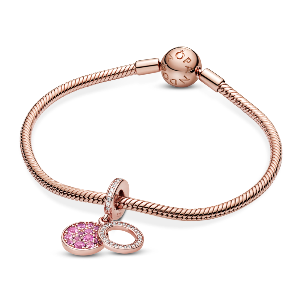 The Pandora Sparkling Pink Disc Double Dangle Charm in 14k Rose Gold plated blend is featured on the Pandora Rose Moments snake chain bracelet.