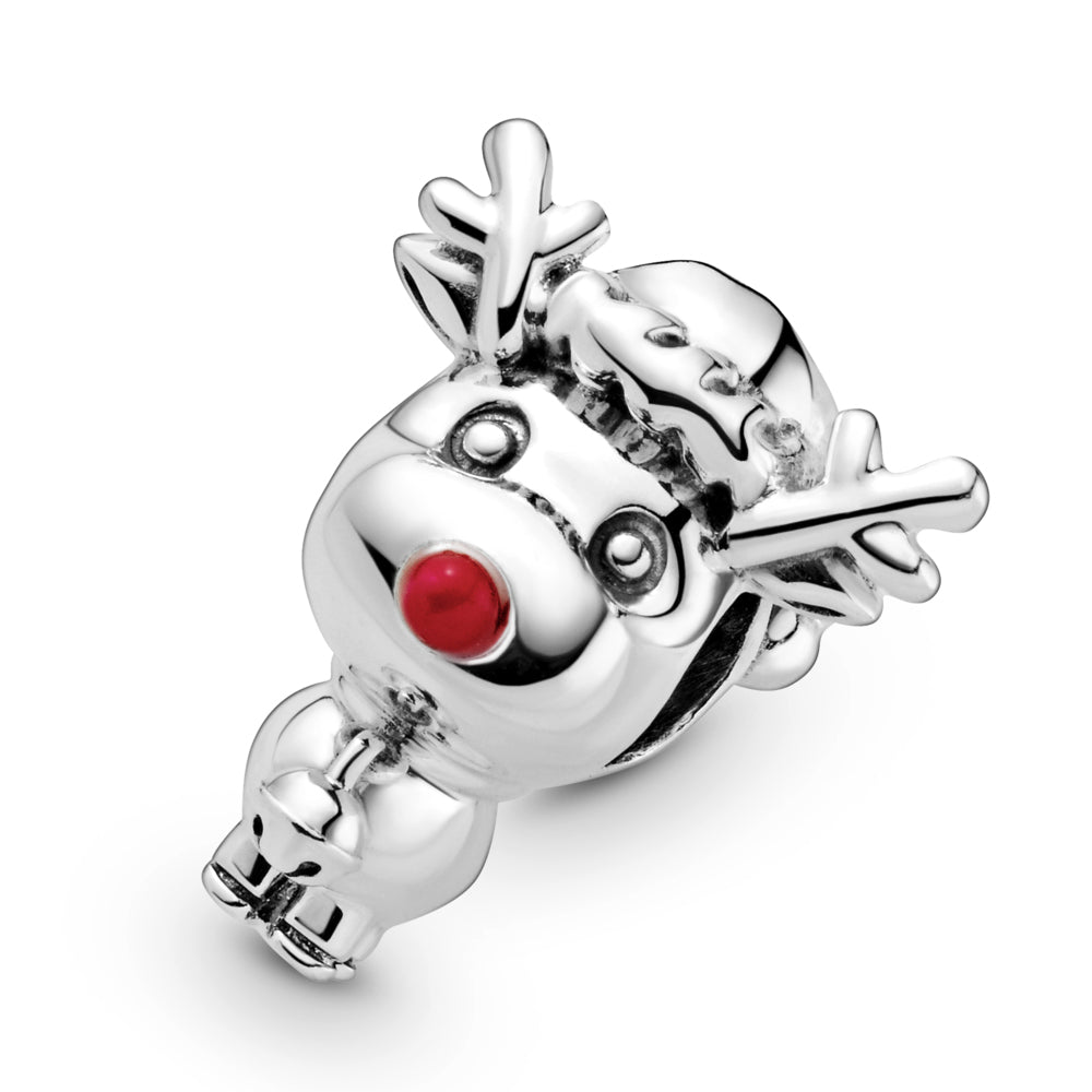 Close up of Pandora Rudolph the Red Nose Reindeer Charm in sterling silver. He has a large head and small body, with antlers, a Christmas hat, small tail, bell, and a big red enamel nose.
