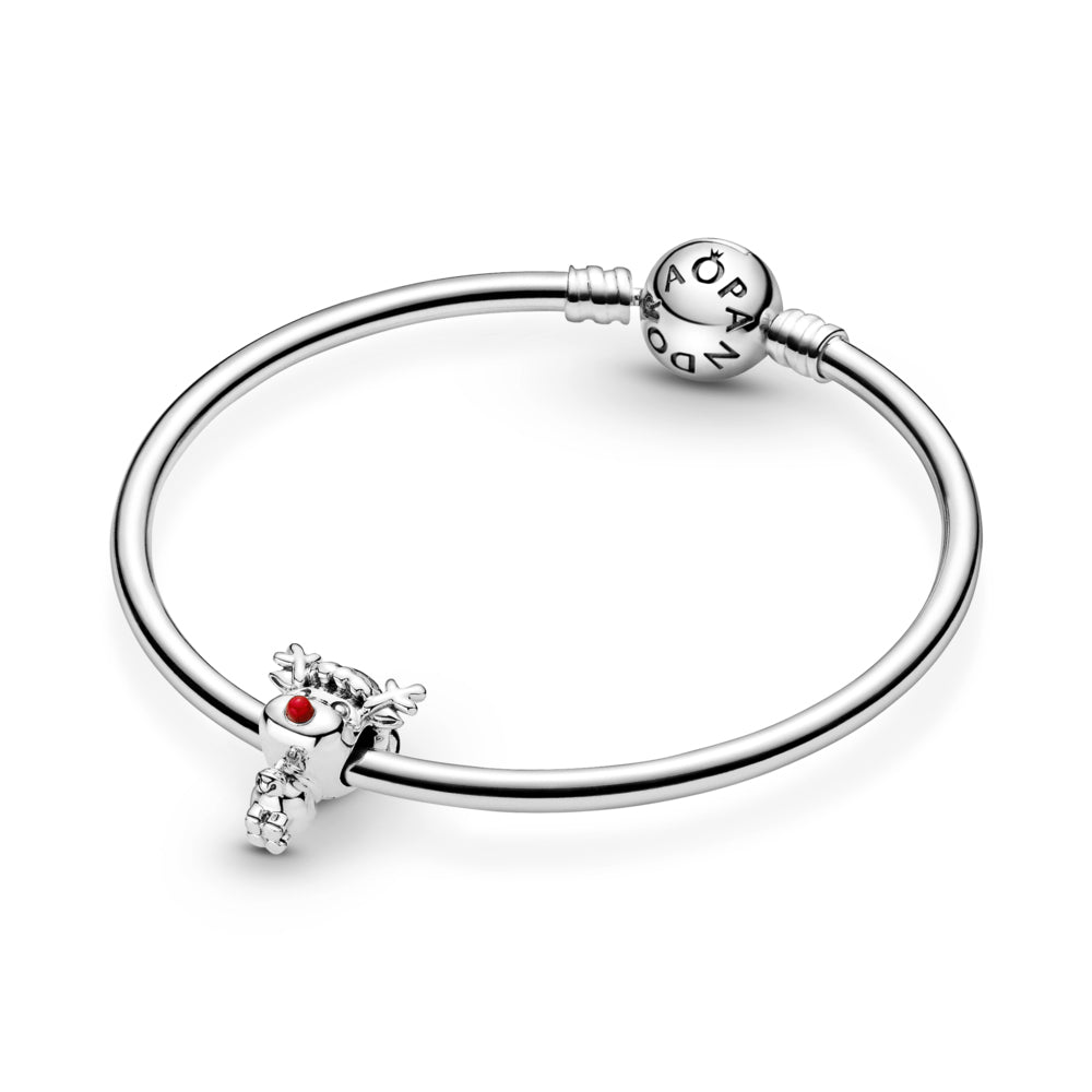 Pandora Rudolph the Red Nose Reindeer Charm in sterling silver featured on smooth moments bangle bracelet. He has a large head and small body, with antlers, a Christmas hat, small tail, bell, and a big red enamel nose.