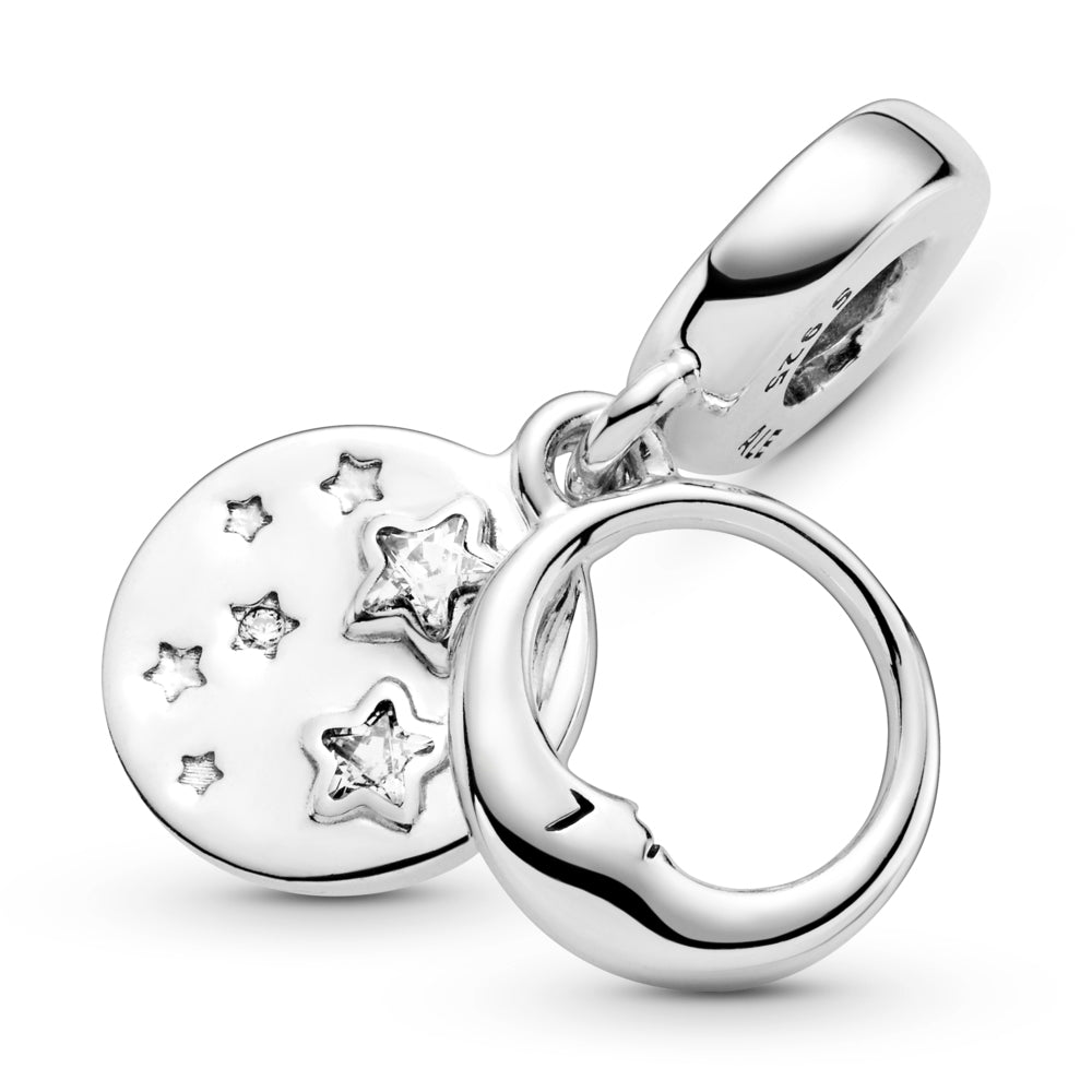 "Close Up of Pandora Sleeping Moon and Stars Dangle Charm in sterling silver. The front dangle has an open circle with a sleeping crescent moon with a face on both sides. The back disc includes stars, some are set with round or star-shaped stones. ""You are my universe"" is engraved on the back with cut-out stars."