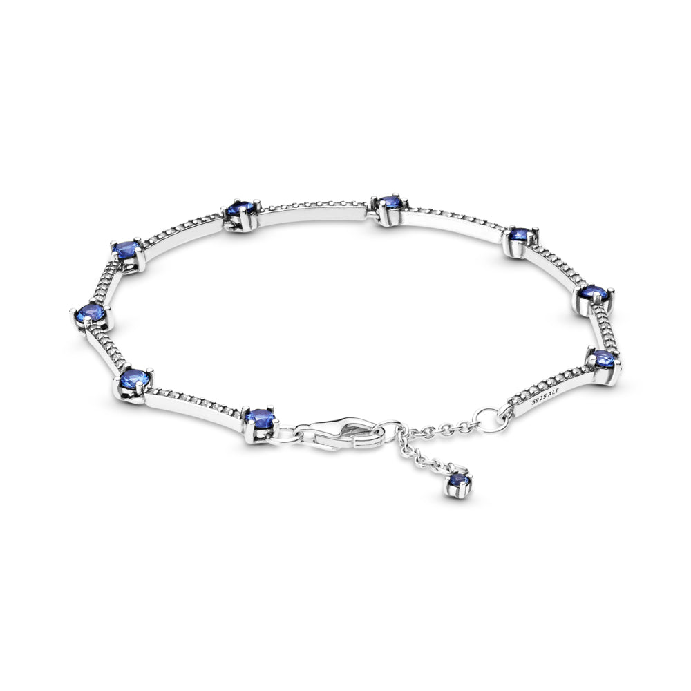 Pandora Sparkling Blue Pavé Bars Bracelet in sterling silver, features rigid bars with small clear cubic zirconia set between larger blue stones, includes a lobster clasp closure with a blue stone dangle tag at the end.