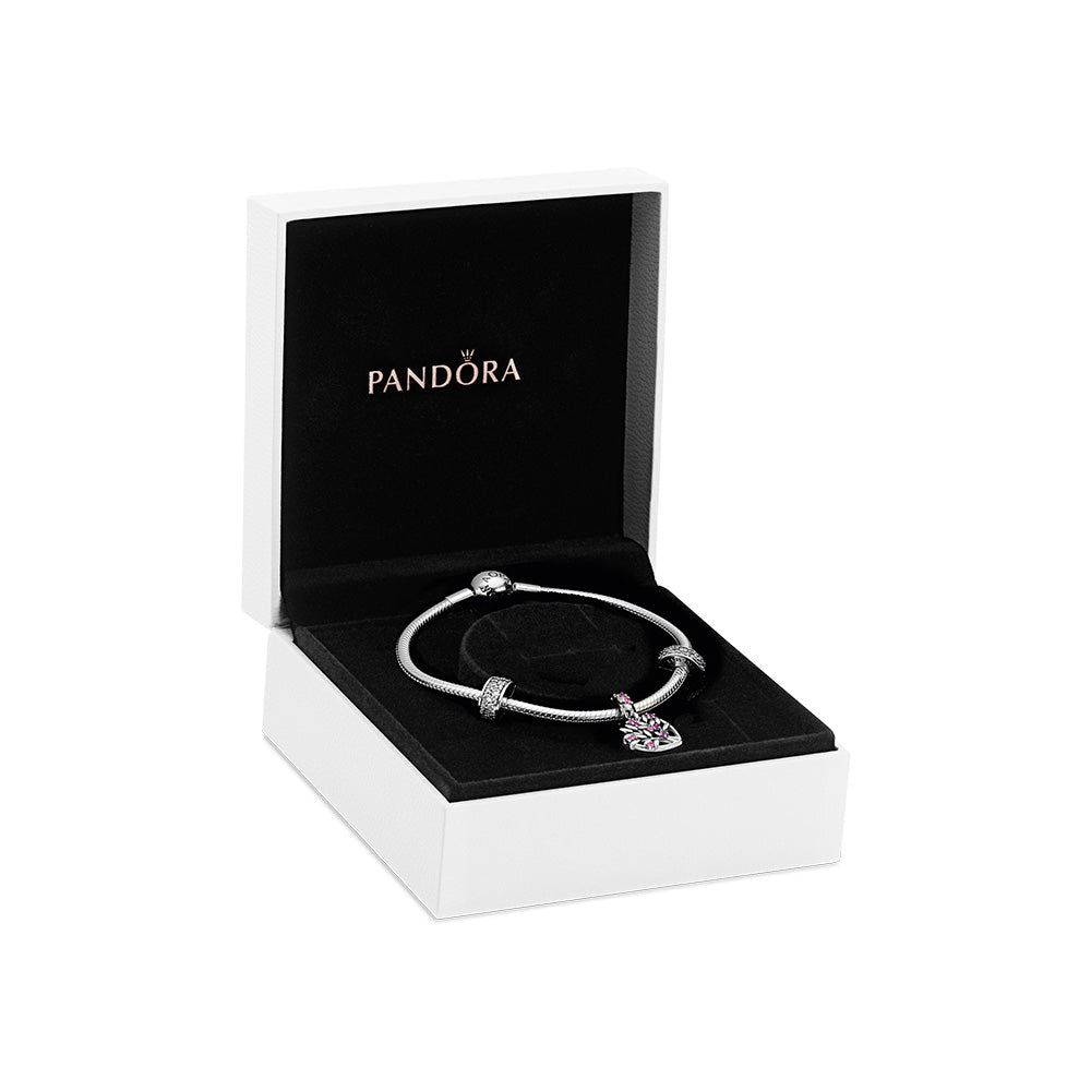 Pandora Sparkling Pink Heart Family Tree Bracelet Gift Set in White Pandora Gift Box. The set features a sterling silver Pandora Moments Snake Chain Bracelet, with 2 Shining Elegance Clips with dazzling cubic zirconia, and the Heart Family Tree Dangle Charm with soft pink and ruby-colored stones is the centerpiece