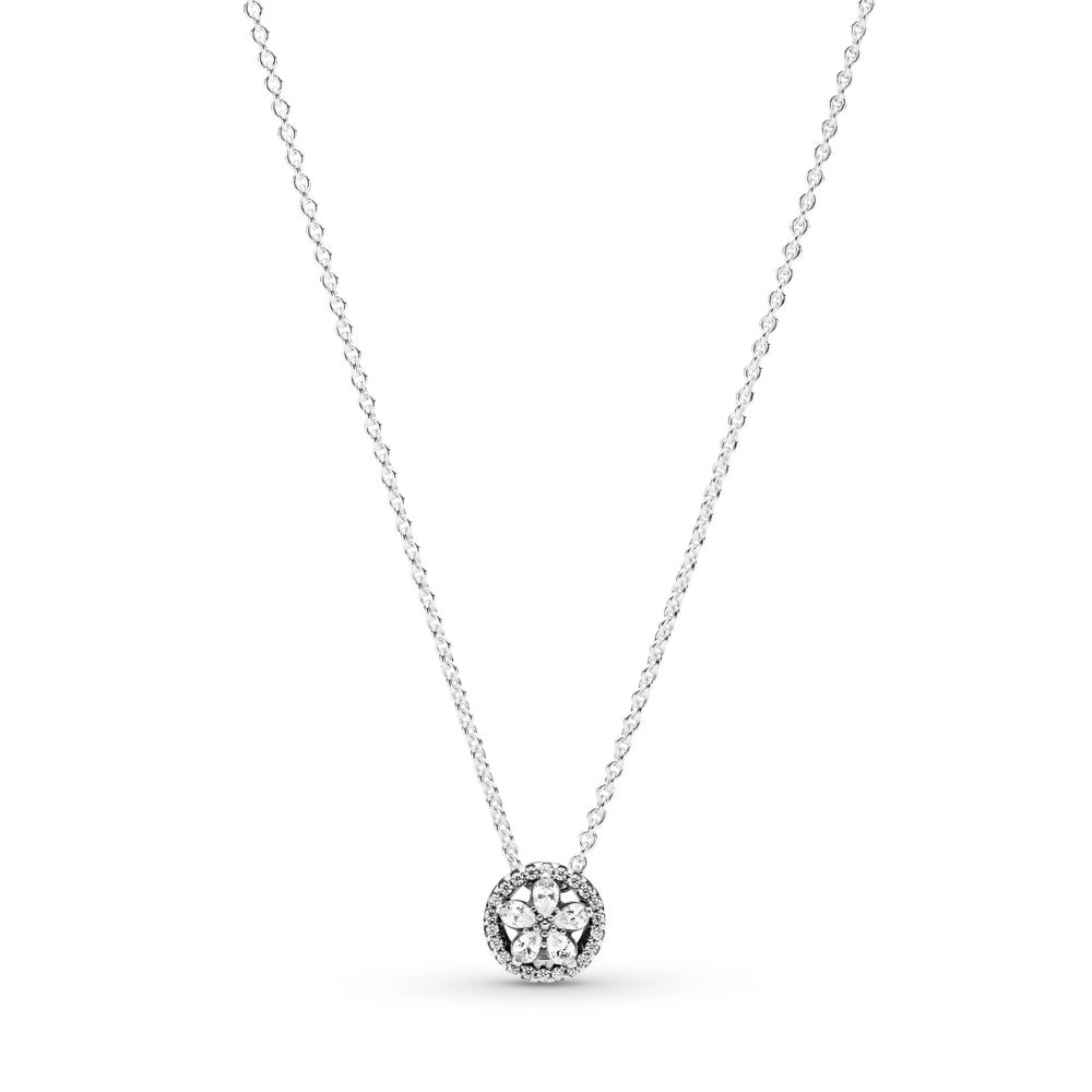 Pandora Sparkling Snowflake Necklace in sterling silver. The necklace features clear stones in the form of a star-like snowflake formation inside a circle decorated with clear cubic zirconia.