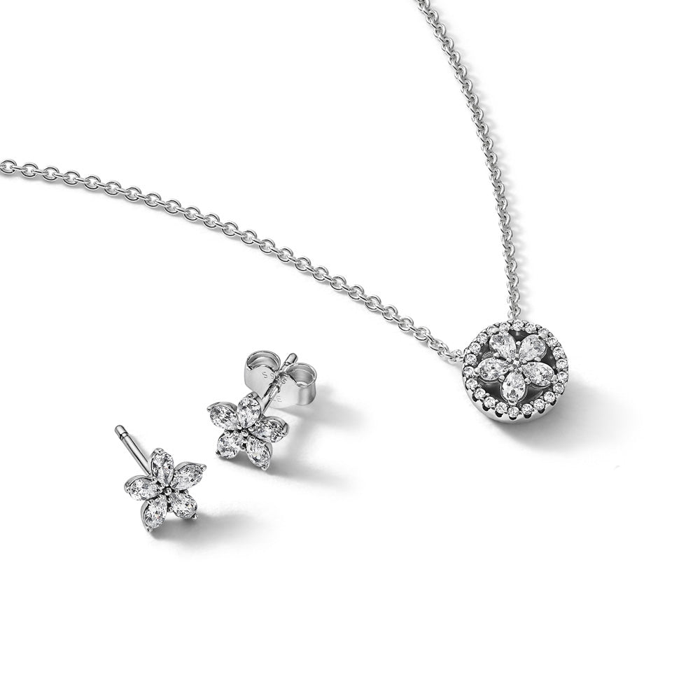 Pandora Sparkling Snowflake Gift Set in sterling silver. Set includes the Sparkling Snowflake Stud Earrings and Sparkling Snowflake Necklace. Both designs feature sparkling clear cubic zirconia set in the shape of a star-like snowflake.