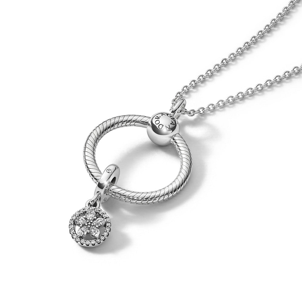Pandora Sparkling Snowflake O Pendant Gift Set in sterling silver. Features a classic sterling silver cable chain necklace, with Pandora Moments O Pendant holding a Sparkling Snowflake Circle Dangle Charm. The charm features five pear-shaped cubic zirconia stones forming a snowflake surrounded by a circle of 22 bead-set cubic zirconia accents.