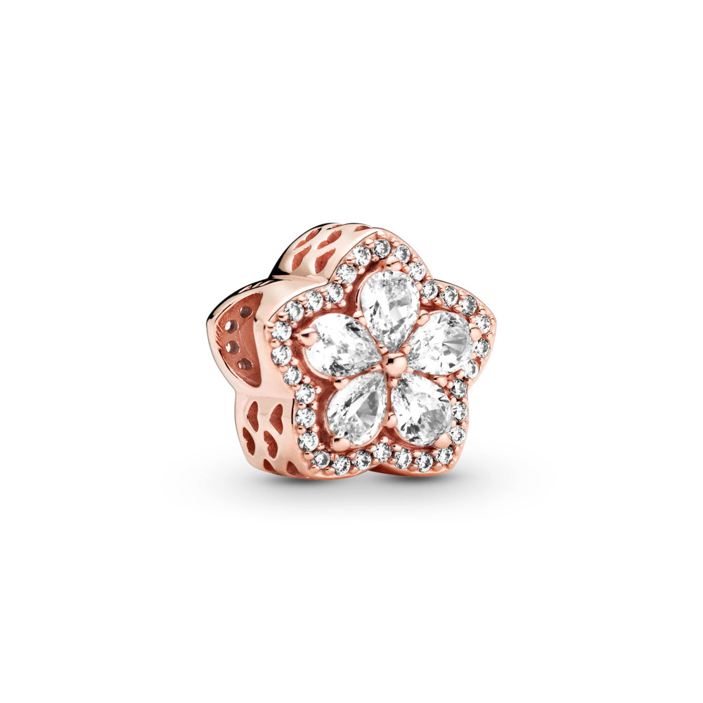 Pandora Rose™ sparkling Snowflake Pavé Charm. The clear pear-shaped stones are set in the form a snowflake star at its center and outlined with clear cubic zirconia and cut-out hearts along the sides.
