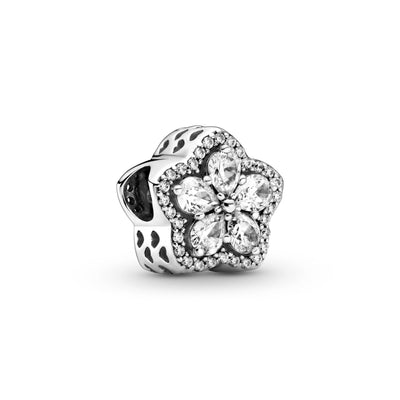Pandora sparkling Snowflake Pavé Charm in sterling silver. The pear-shaped stones are set in the form a snowflake star at its center and outlined with clear cubic zirconia and cut-out hearts along the sides.