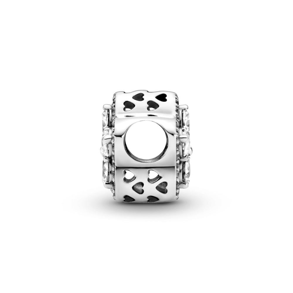 Profile of Pandora sparkling Snowflake Pavé Charm in sterling silver. The pear-shaped stones are set in the form a snowflake star at its center and outlined with clear cubic zirconia and cut-out hearts along the sides.