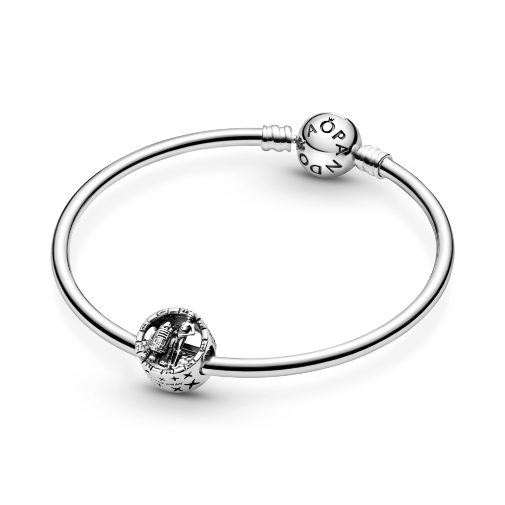 "Pandora Star Wars C-3PO and R2-D2 Openwork Charm in Sterling Silver featured on Pandora Moments smooth sterling silver bangle.  The bottom of the charm shows the engraving ""FAR FAR AWAY"""
