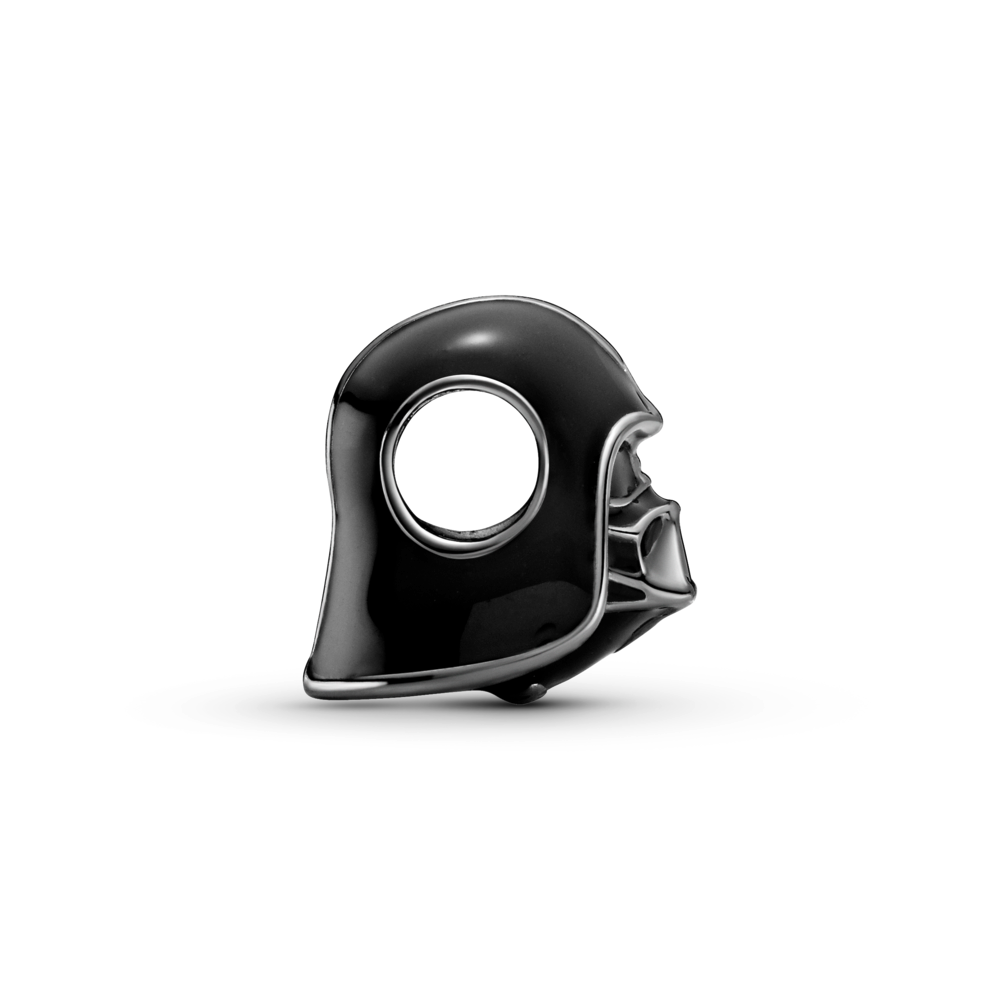 Profile view of Pandora Star Wars Darth Vader Charm in oxidized sterling silver with black enamel. The charm features Darth Vader's head, face mask and helmet. in life like detail. The circular charm opening is shown centered through the side of his helmet.