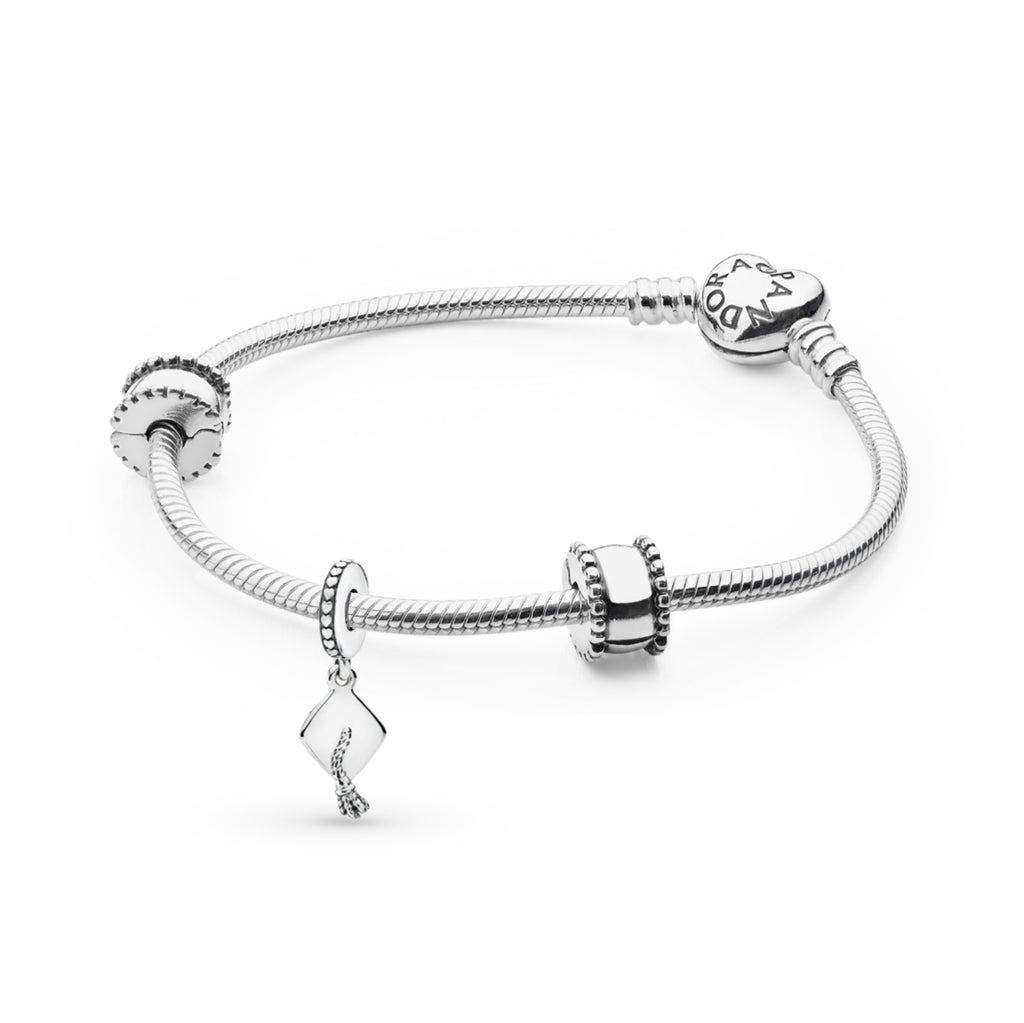 Pandora moments sterling silver heart clasp snake chain bracelet featuring the graduation cap dangle charm as the centerpiece and framed with with 2 sterling silver beveled and smooth clip charms.