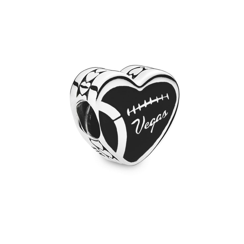 Pandora Vegas loves football exclusive silver charm in heart shape with black enamel engraving against the silver football threads; and Vegas in script.