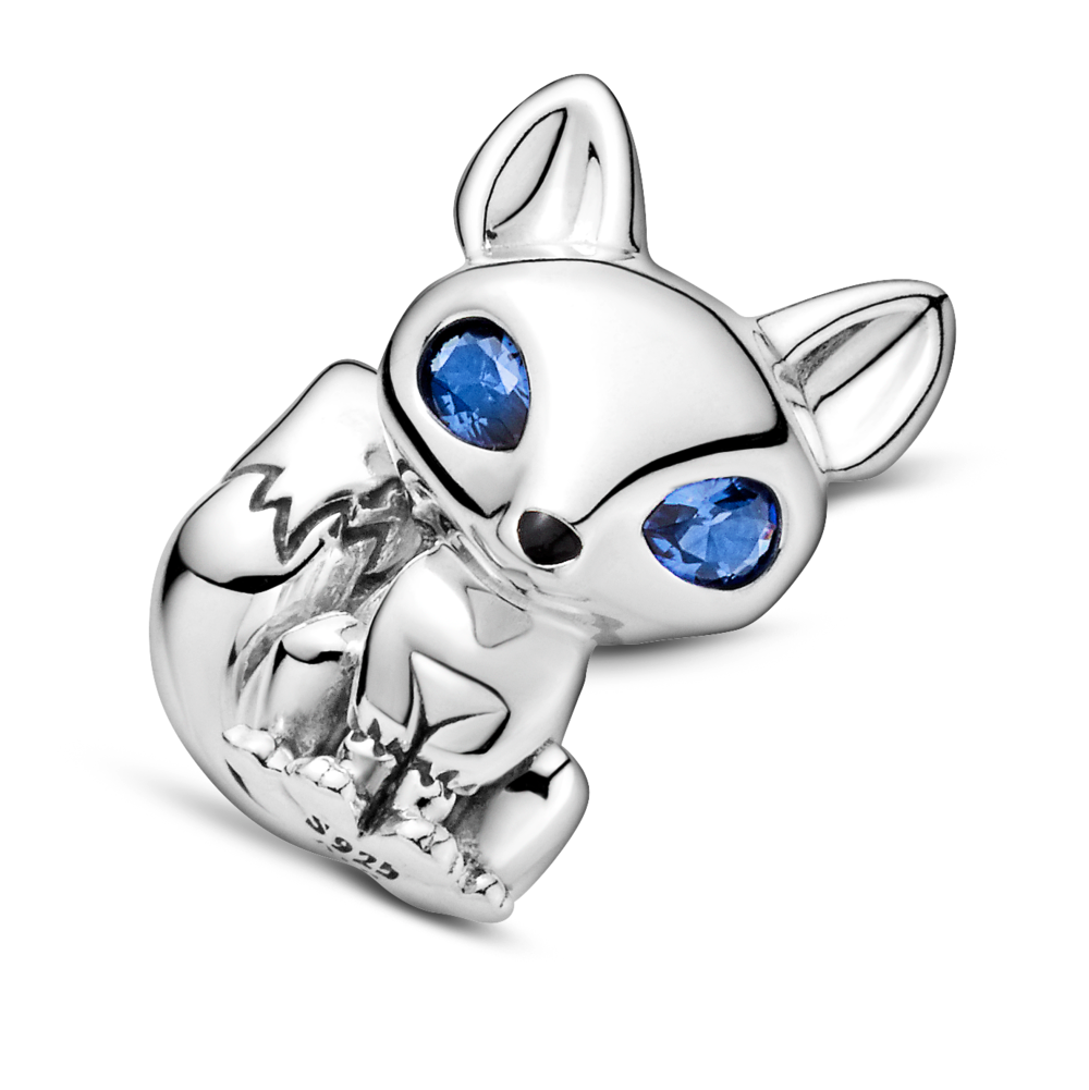 close up of pandora blue-eyed fox charm with pear cut blue crystal eyes, black enamel nose, in sitting position in sterling silver