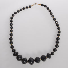 "Black 11"" necklace to support African Reconciliation Ministries"