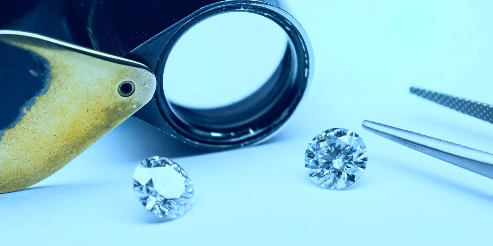 Lab grown diamonds with a jewellers loupe
