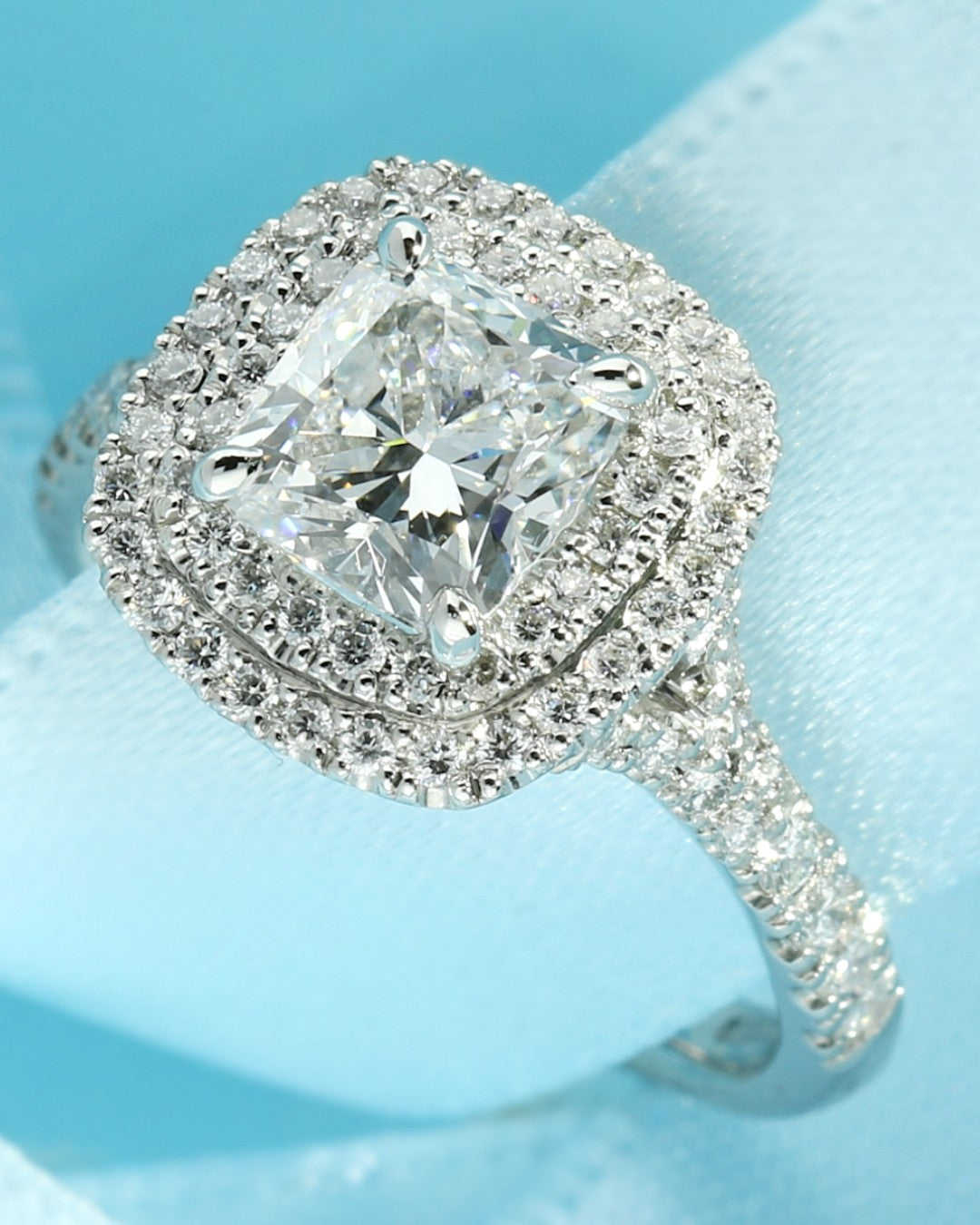 Double halo engagement ring set with a cushion cut lab grown diamond set with many accent lab diamonds