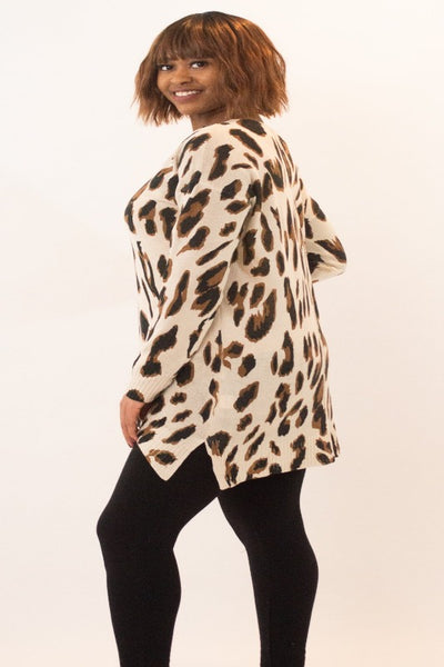 Leopard Print, loose fit, v-neck, tunic sweater with slide slits.