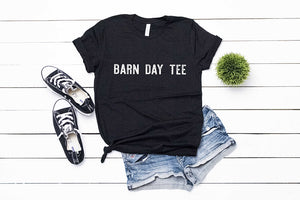 short sleeved black tshirt with white lettering reading barn day tee