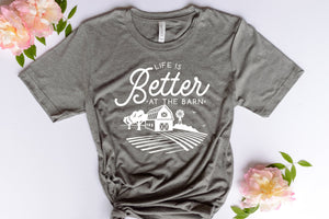 grey short sleeve graphic tshirt that reads life is better at the barn with a barn scene.