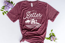 Load image into Gallery viewer, maroon short sleeve graphic tshirt that reads life is better at the barn with a barn scene.