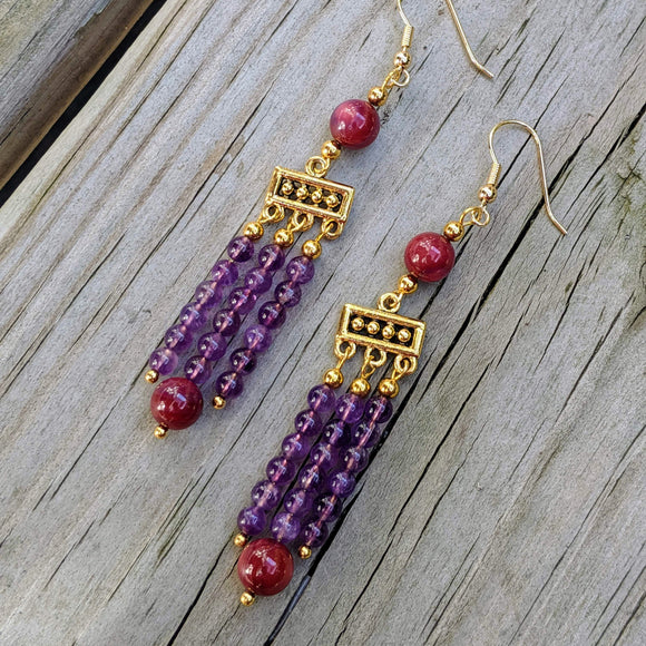 Golden chandelier earrings with three long rows of amethyst