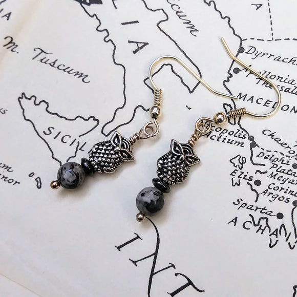 Gray crazy lace agate owl dangle earrings against a map of the ancient Mediterranean