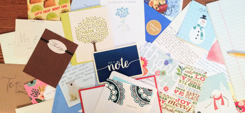 An assortment of notes and cards with personal notes from students