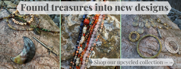 Found treasures into new designs: an array of jewelry parts are arranged on large rocks, ready to be upcycled. Click to shop our upcycled collection