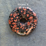 40mm Red Snowflake Jasper Stone Donut on black waxed cotton cord