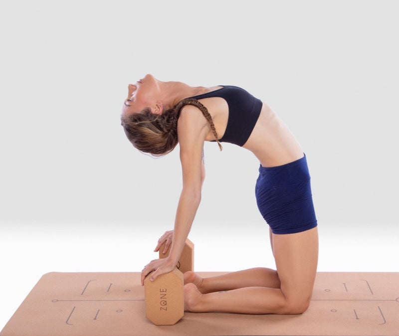 girl practicing with cork yoga blocks